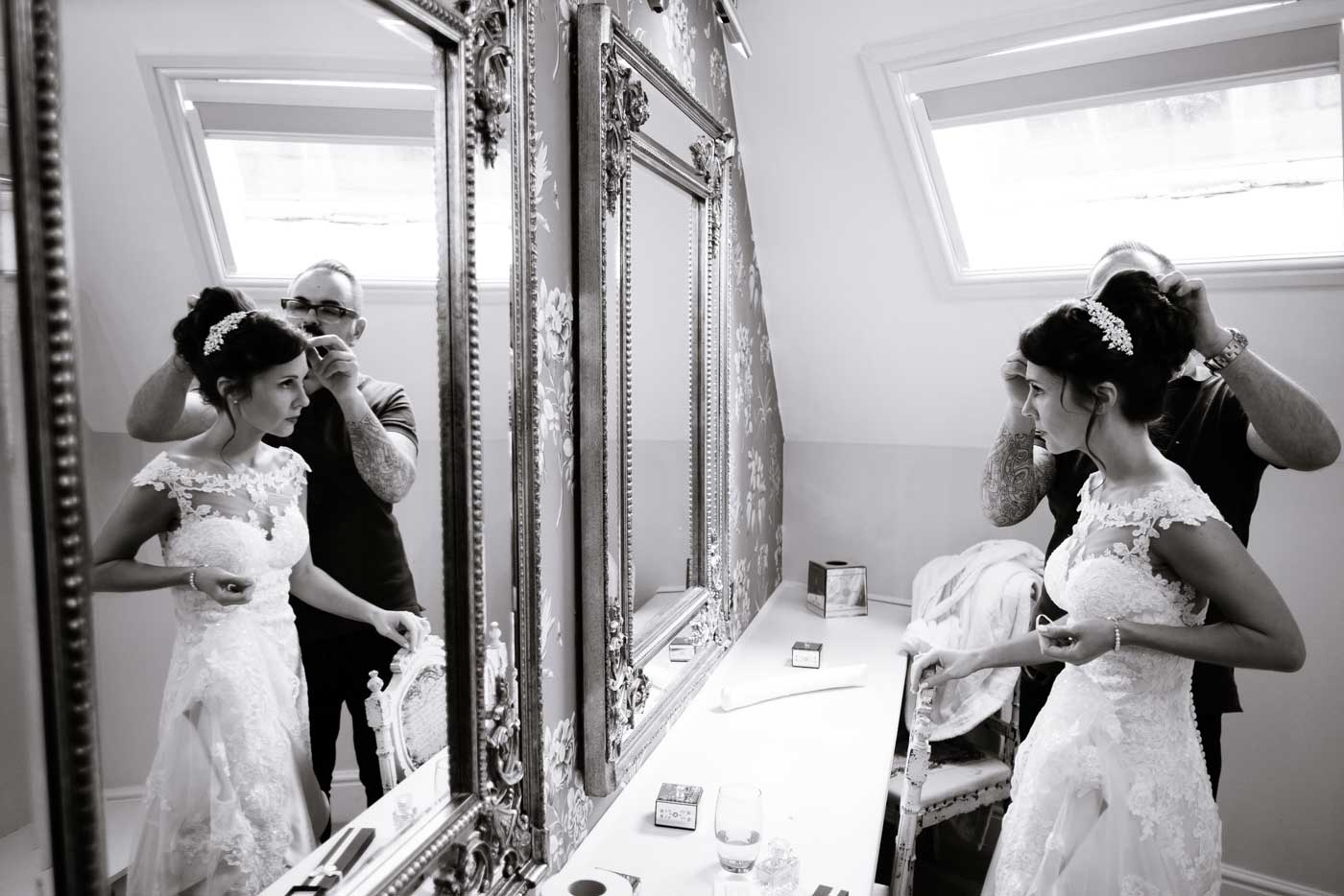 Bride having her veil put on before her Stanbrook Abbey wedding by Stanbrook Abbey wedding photographer Clive Blair Photography