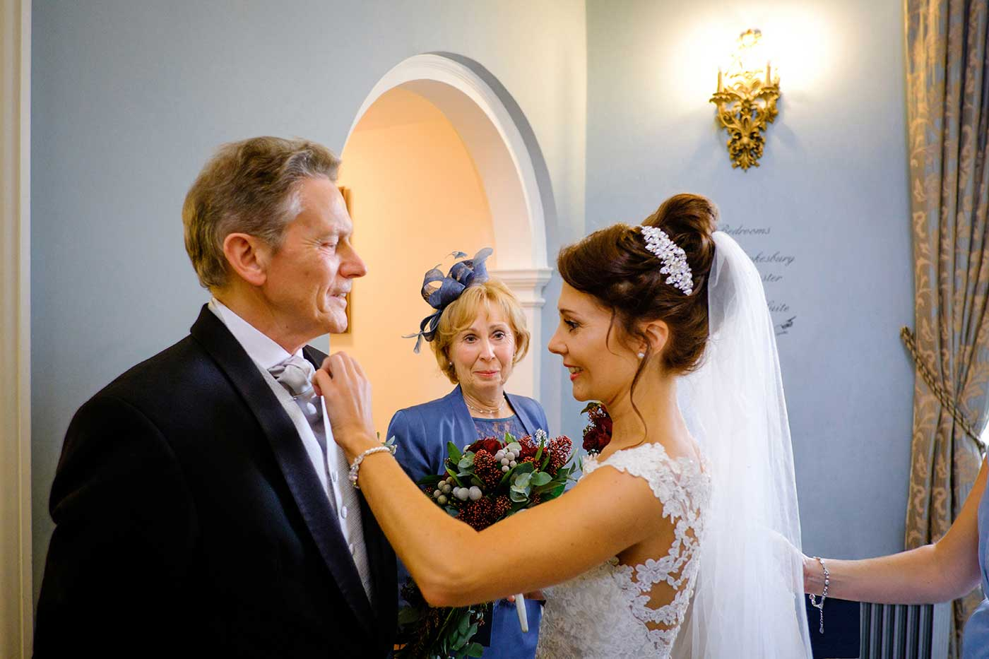 Bride adjusting her father's button-hole
