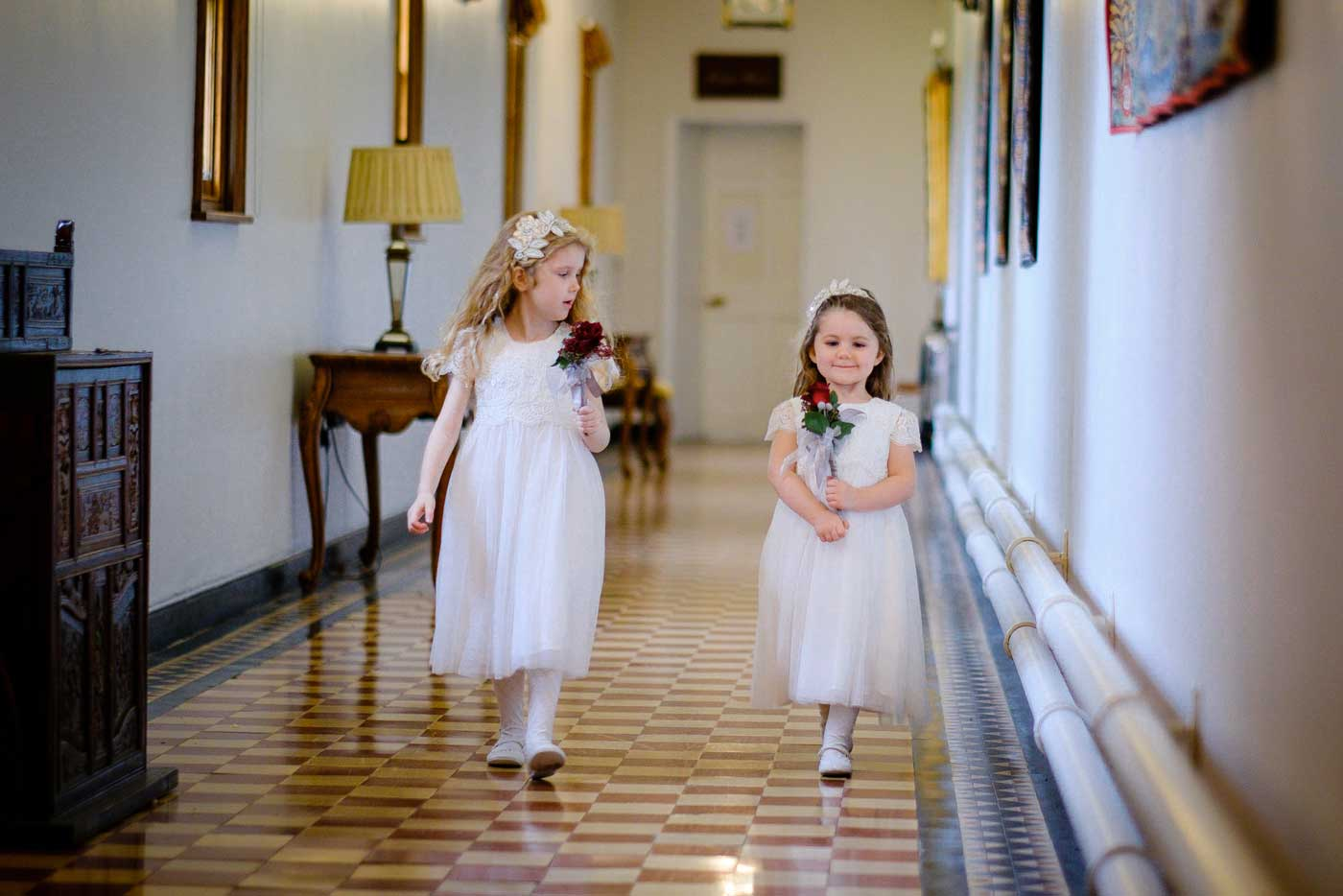 Flower girls on the way to the wedding ceremony at Stanbrook Abby by Stanbrook Abbey wedding photographer Clive Blair Photography
