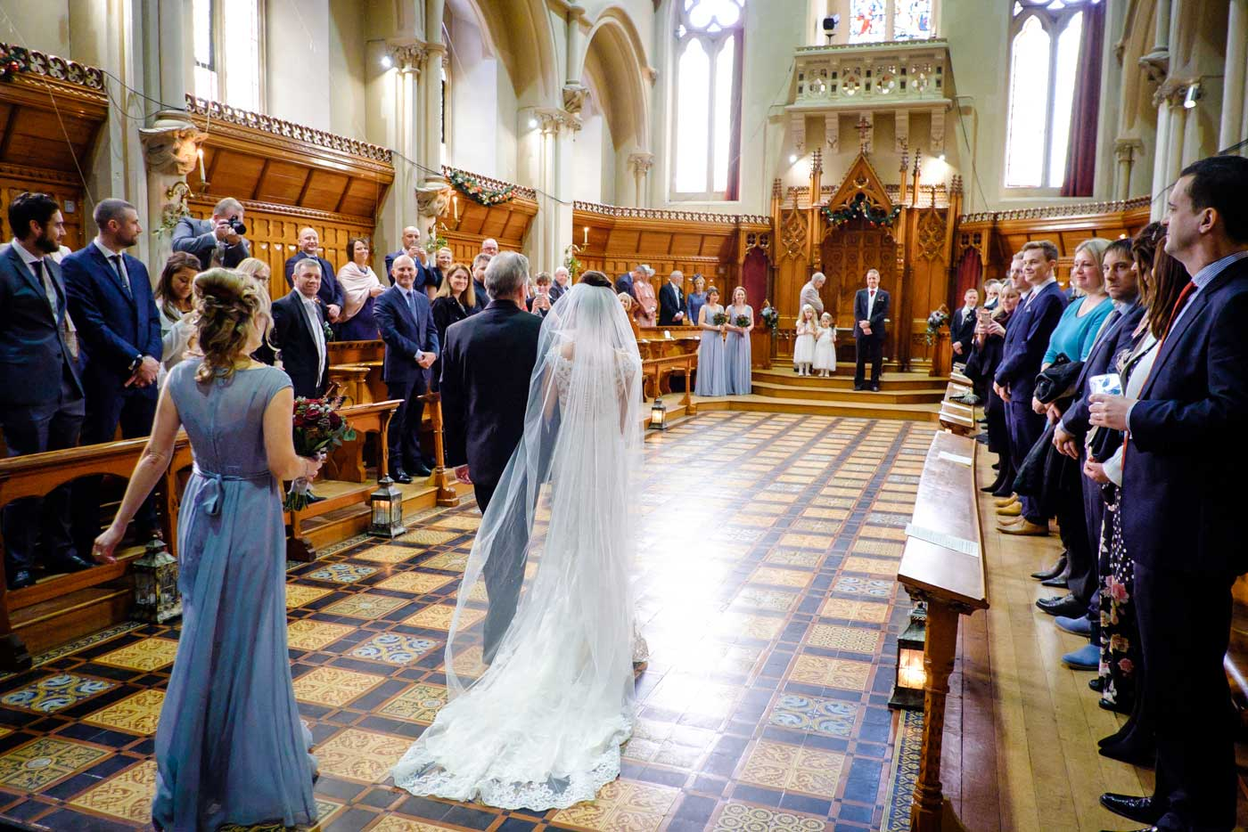 Bride entering The Callow Great Hall at Stanbrook Abbey by Stanbrook Abbey wedding photographer Clive Blair Photography