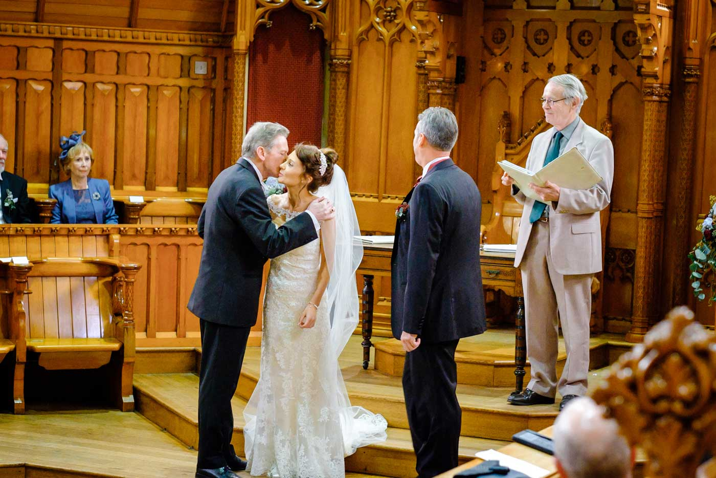 Bride giving her father a kiss before her wedding at The Callow Great Hall at Stanbrook Abbey