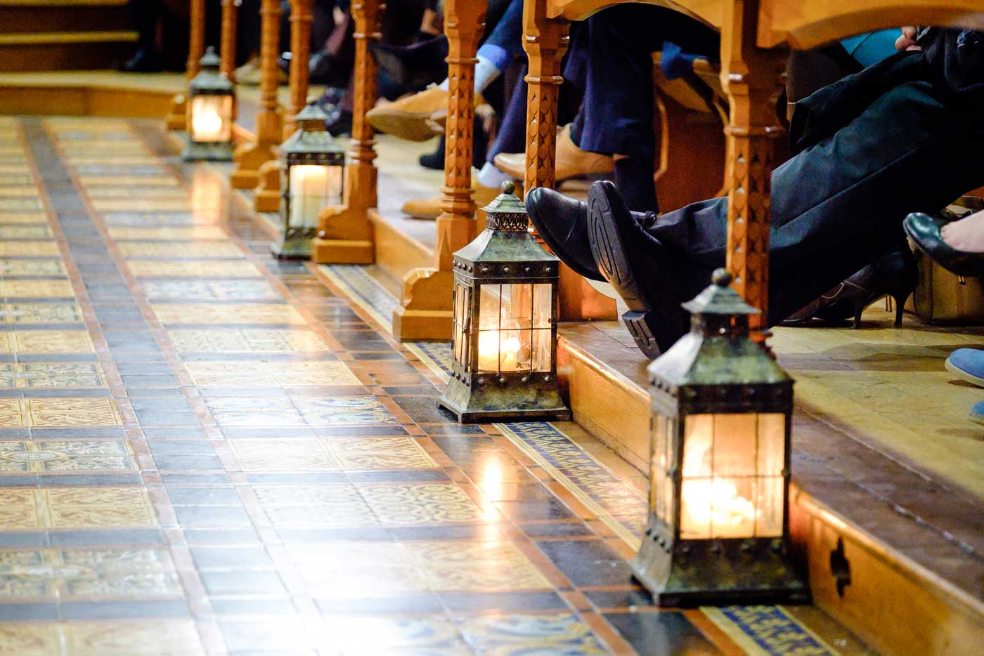 Candleholders on the floor during a wedding ceremony in The Callow Great Hall at Stanbrook Abbey