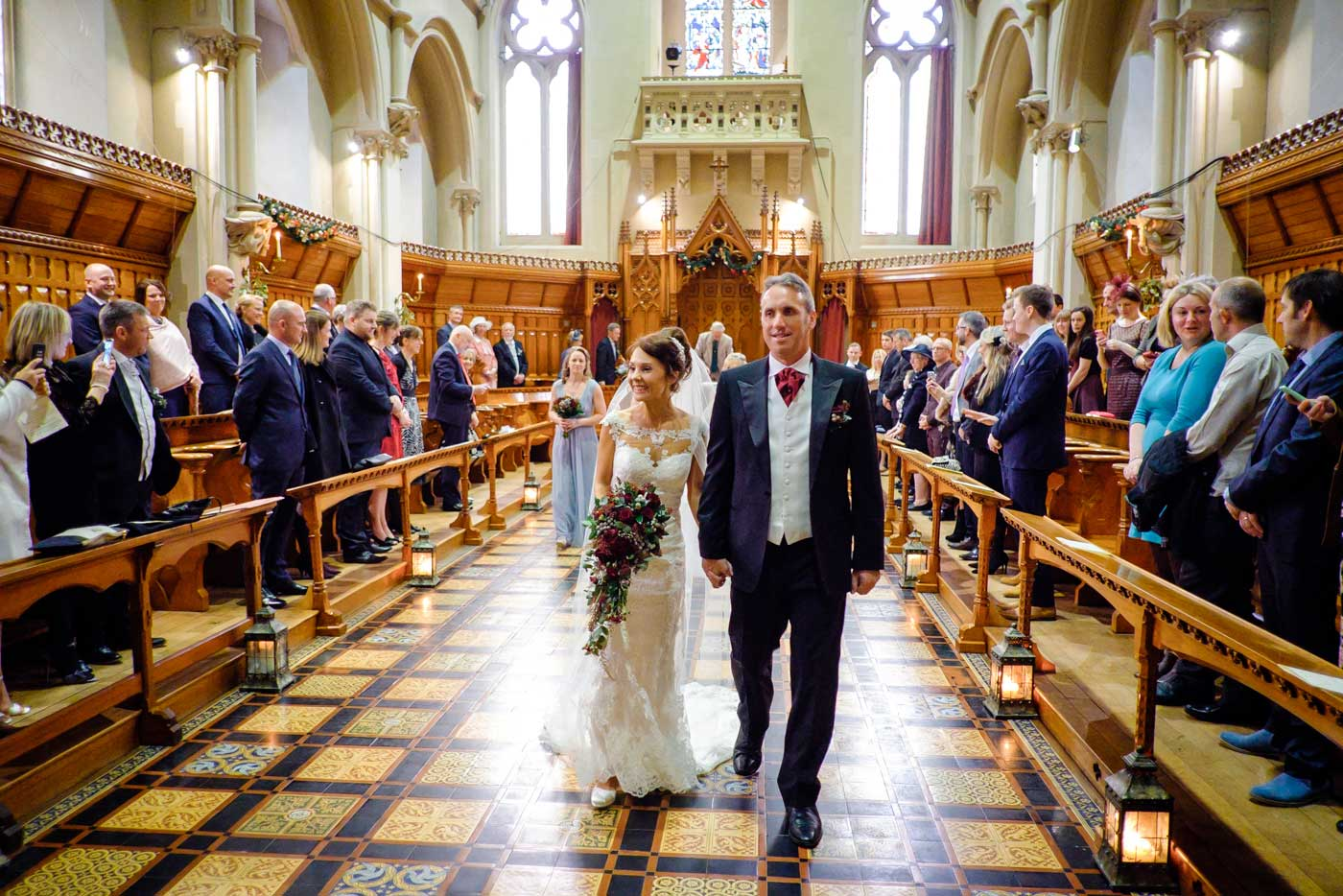 Bride and groom exciting The Callow Great Hall at Stanbrook Abbey by Stanbrook Abbey wedding photographer Clive Blair Photography