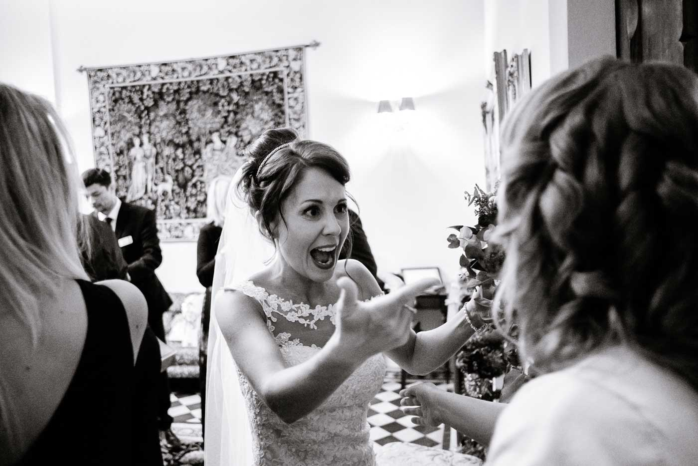 Happy bride surprised to see wedding guest at her Stanbrook Abbey wedding