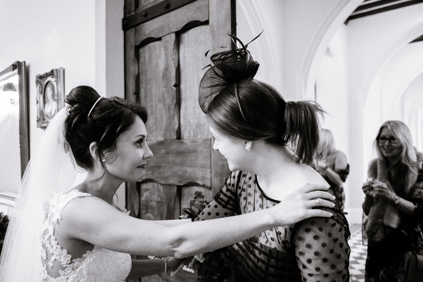Bride greeting woman guest