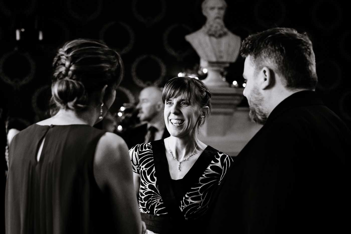 Happy woman during drinks reception at a Stanbrook Abbey wedding