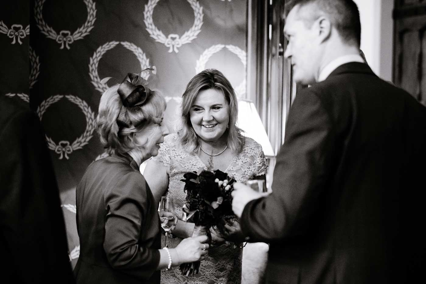Woman chatting to bride's mother at a Stanbrook Abbey wedding