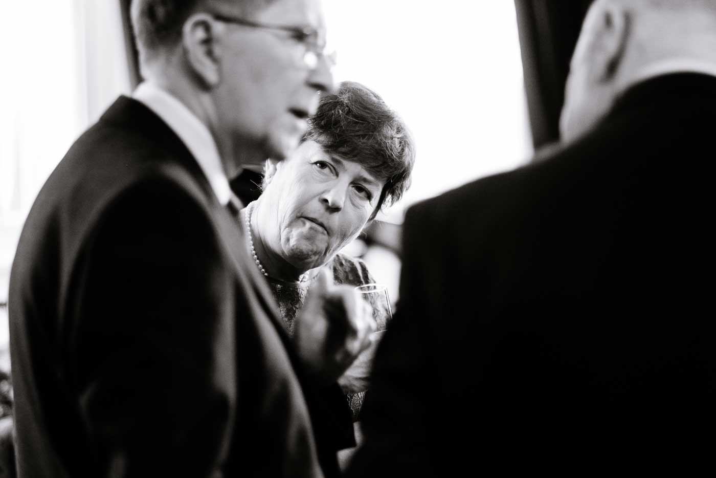 Woman listening carefully as a man speaks at Stanbrook Abbey