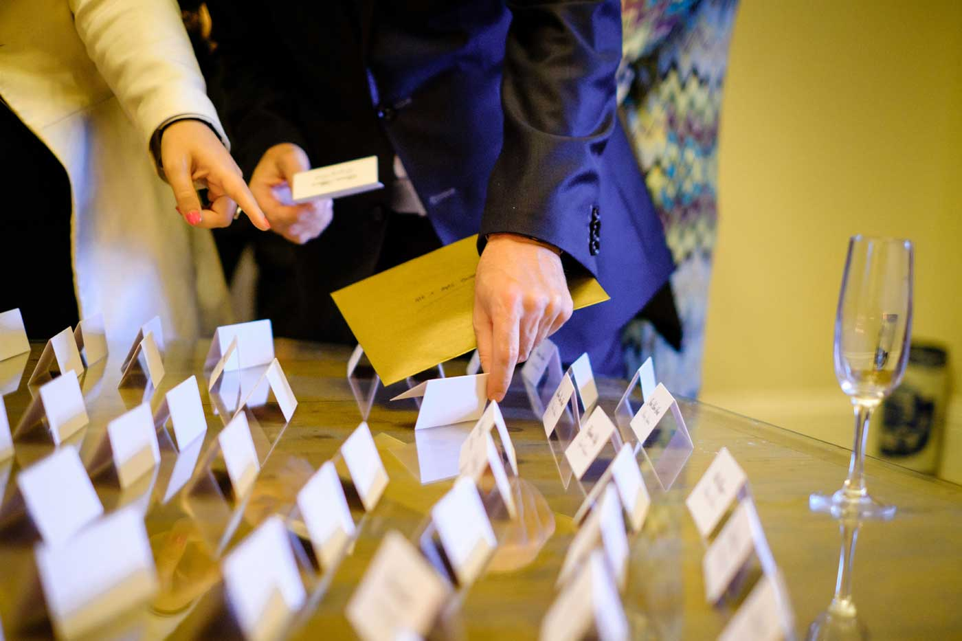 Wedding guests taking their placenames as they enter St Annes' Hall
