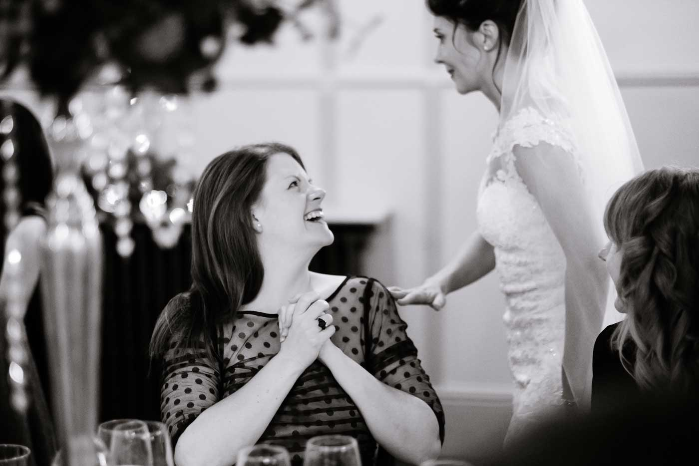 Happy guests during wedding ceremony at Stanbrook Abbey