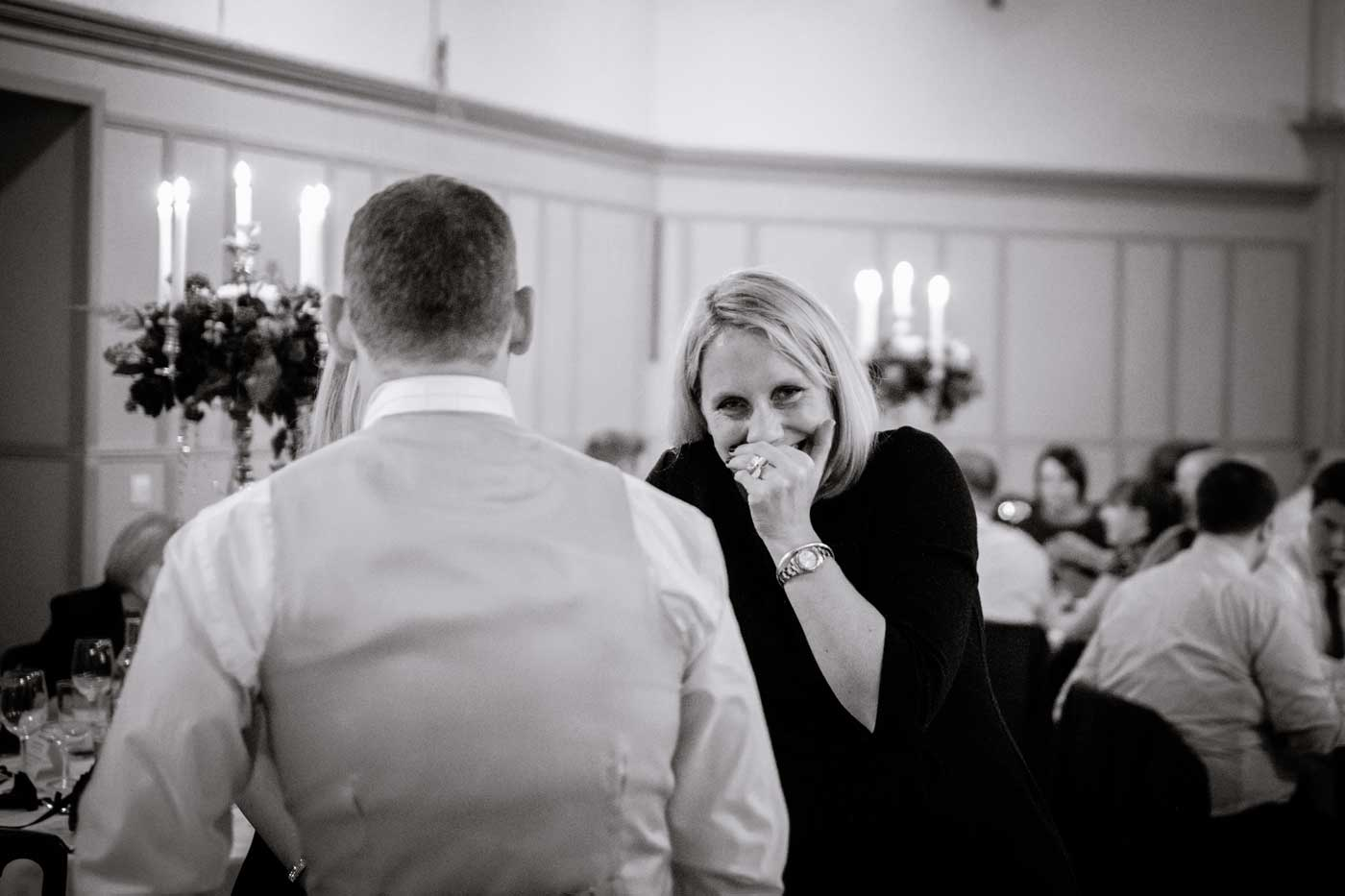 Woman laughing by Stanbrook Abbey wedding photographer Clive Blair Photography