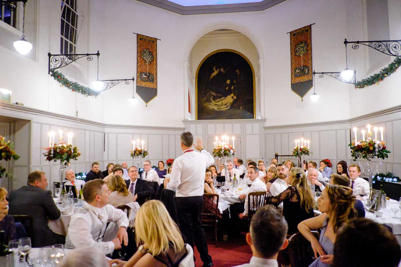 Groom giving his speech in St Anne's Hall in Stanbrook Abbey by Stanbrook Abbey wedding photographer Clive Blair Photography