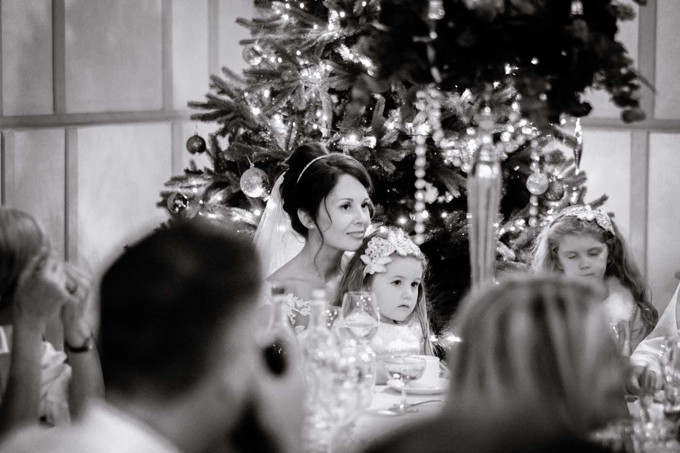 Bride liteing to groom's speech