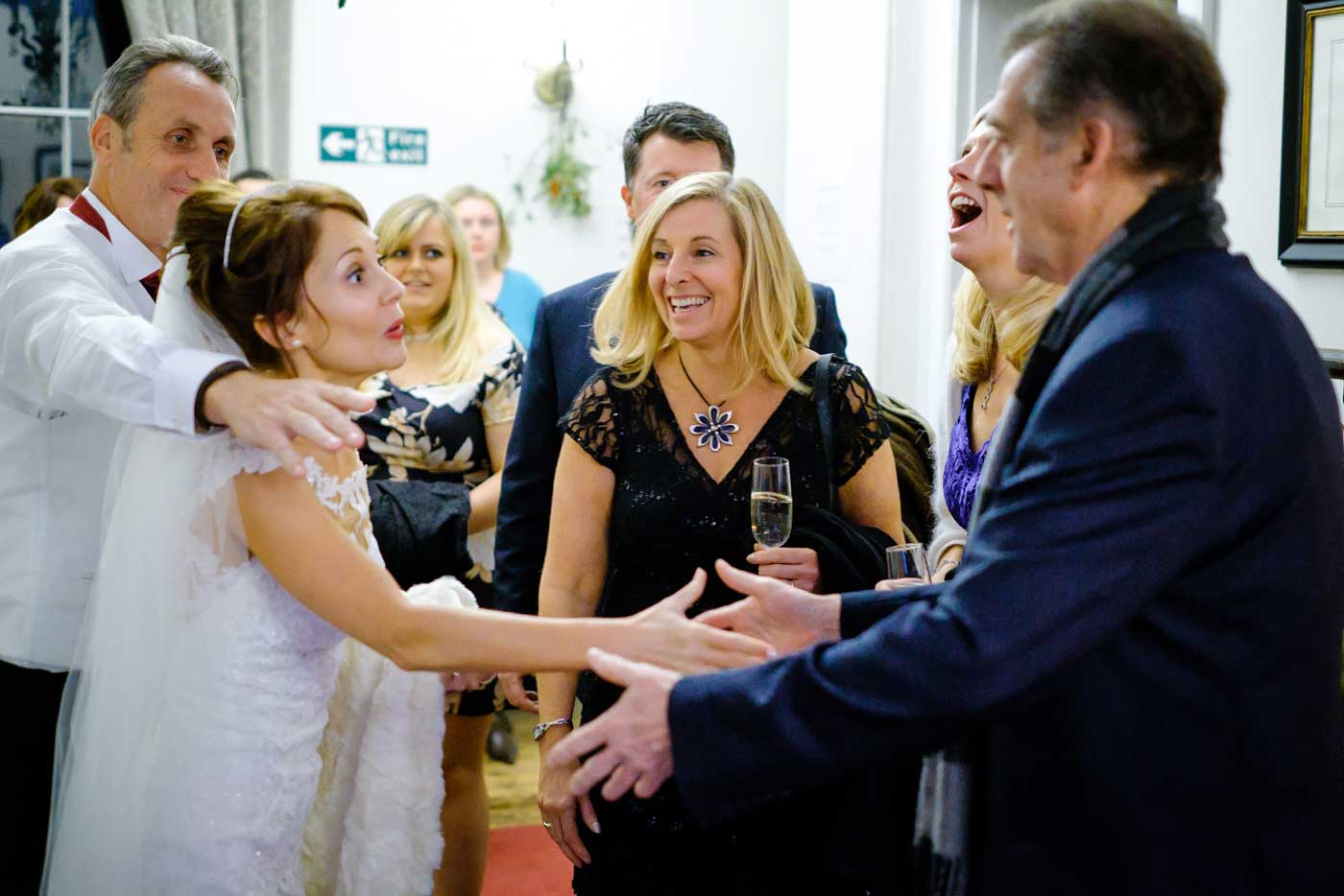 Bride and groom greeting evening guests at their Stanbrook Abbey wedding