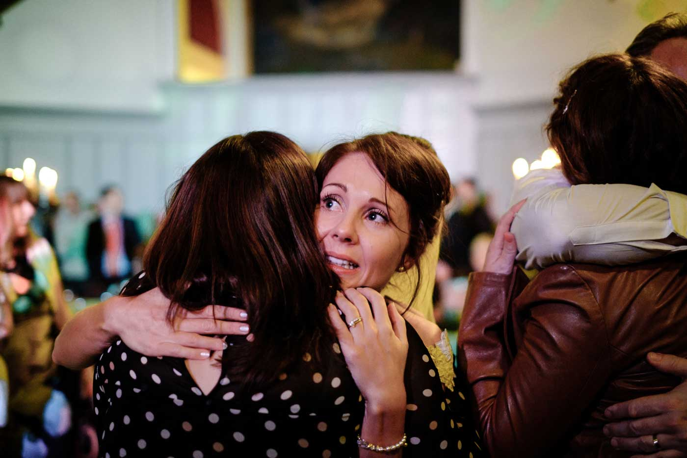 Tearful bride greeting eveing guests at her Stanbrook Abbey wedding by Stanbrook Abbey wedding photographer Clive Blair Photography