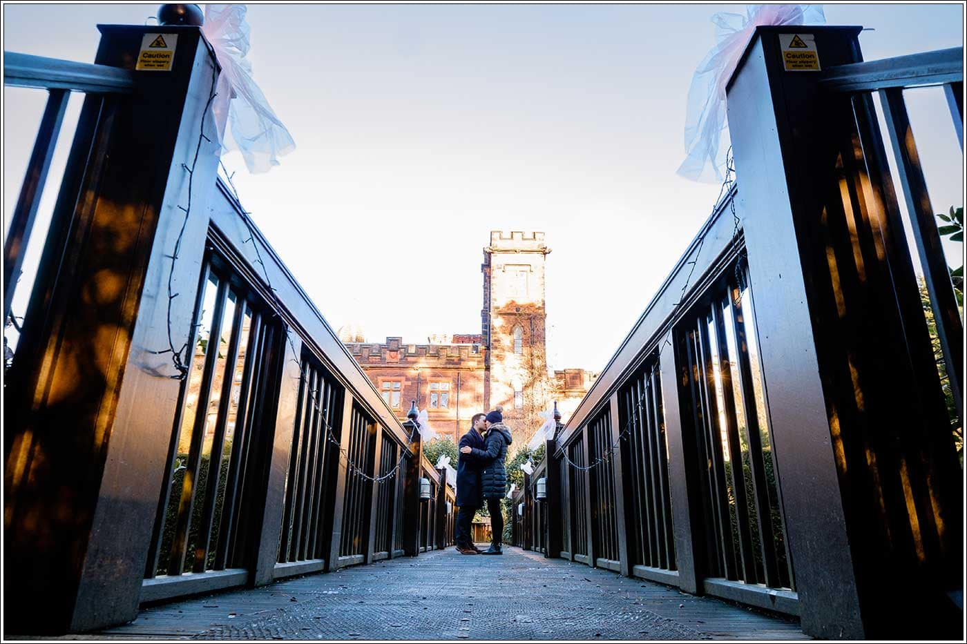 Man and woman on bridge at New Hall Hotel by Clive Blair Photography