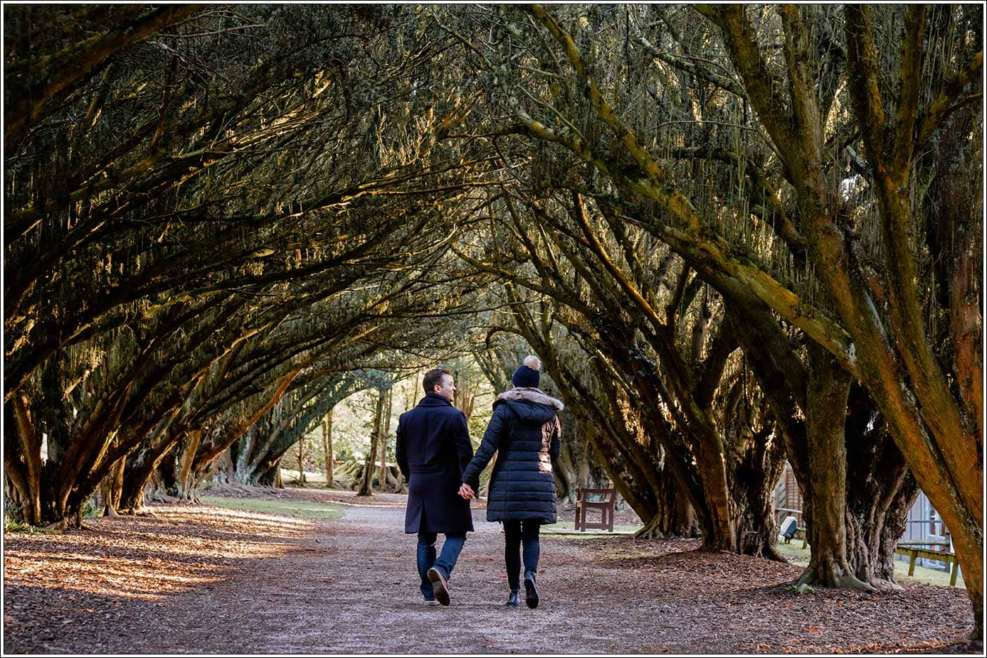 Man and woman walking in grounds of New Hall Hotel after his surprise proposal