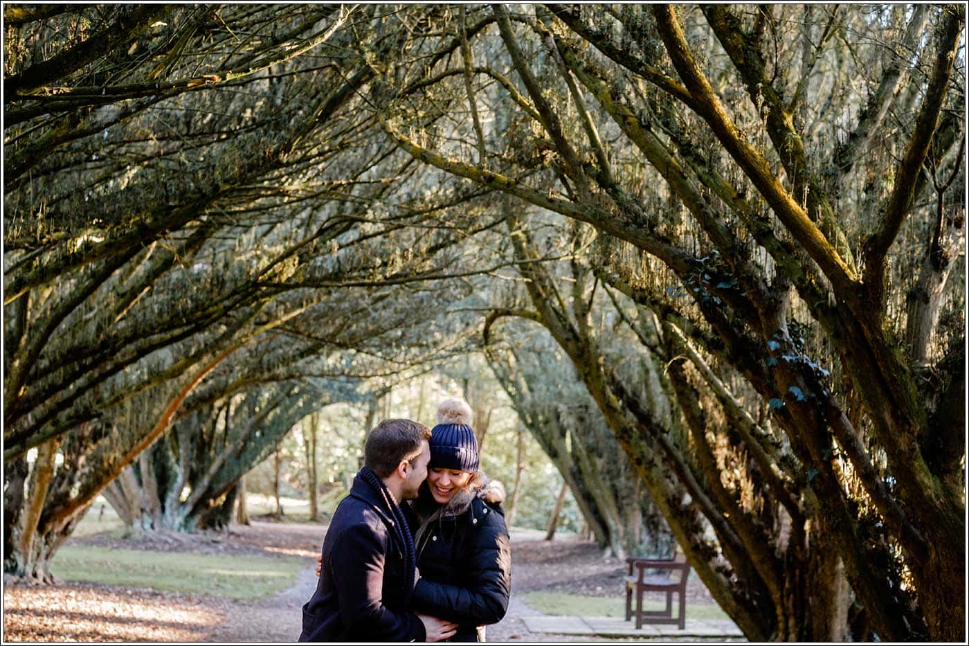 Man hugging his new fiancee after his simple proposal idea at New Hall by Clive Blair Photography