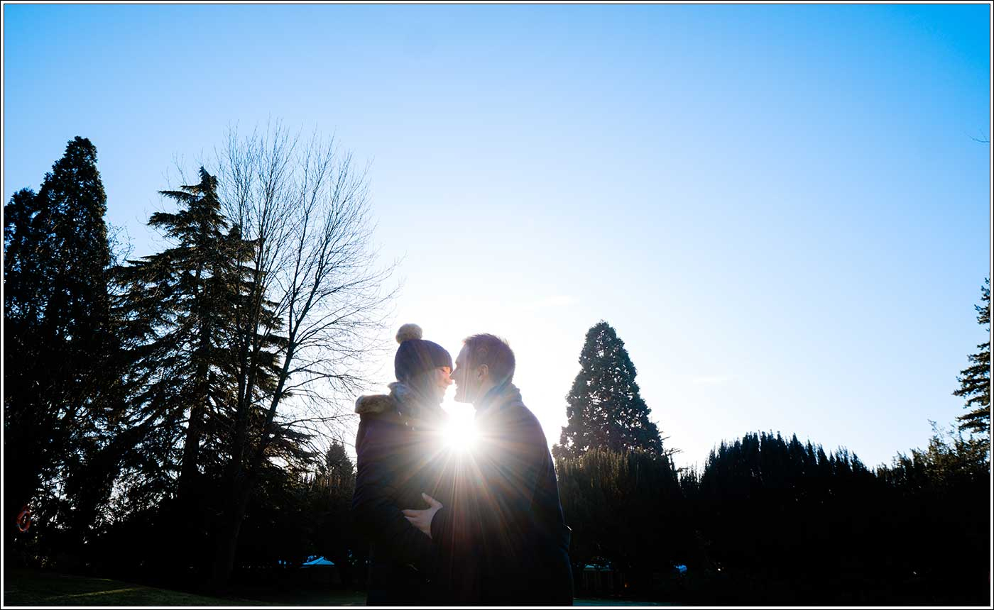 Man and woman backlight after she's just accepted his wedding proposal