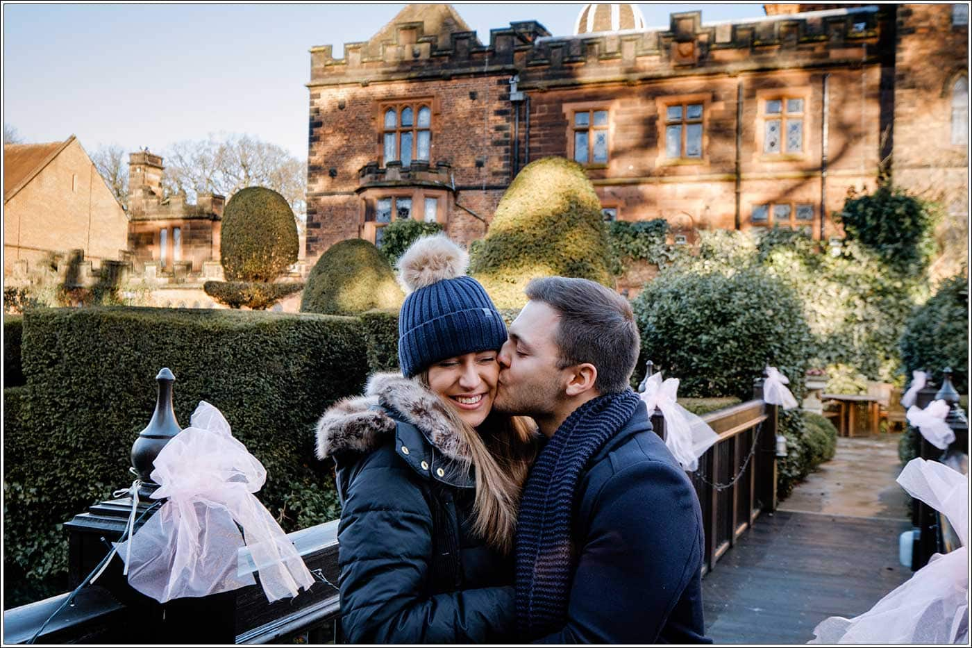 Man kissing his new fiancee after his secret proposal at New Hall Hotel