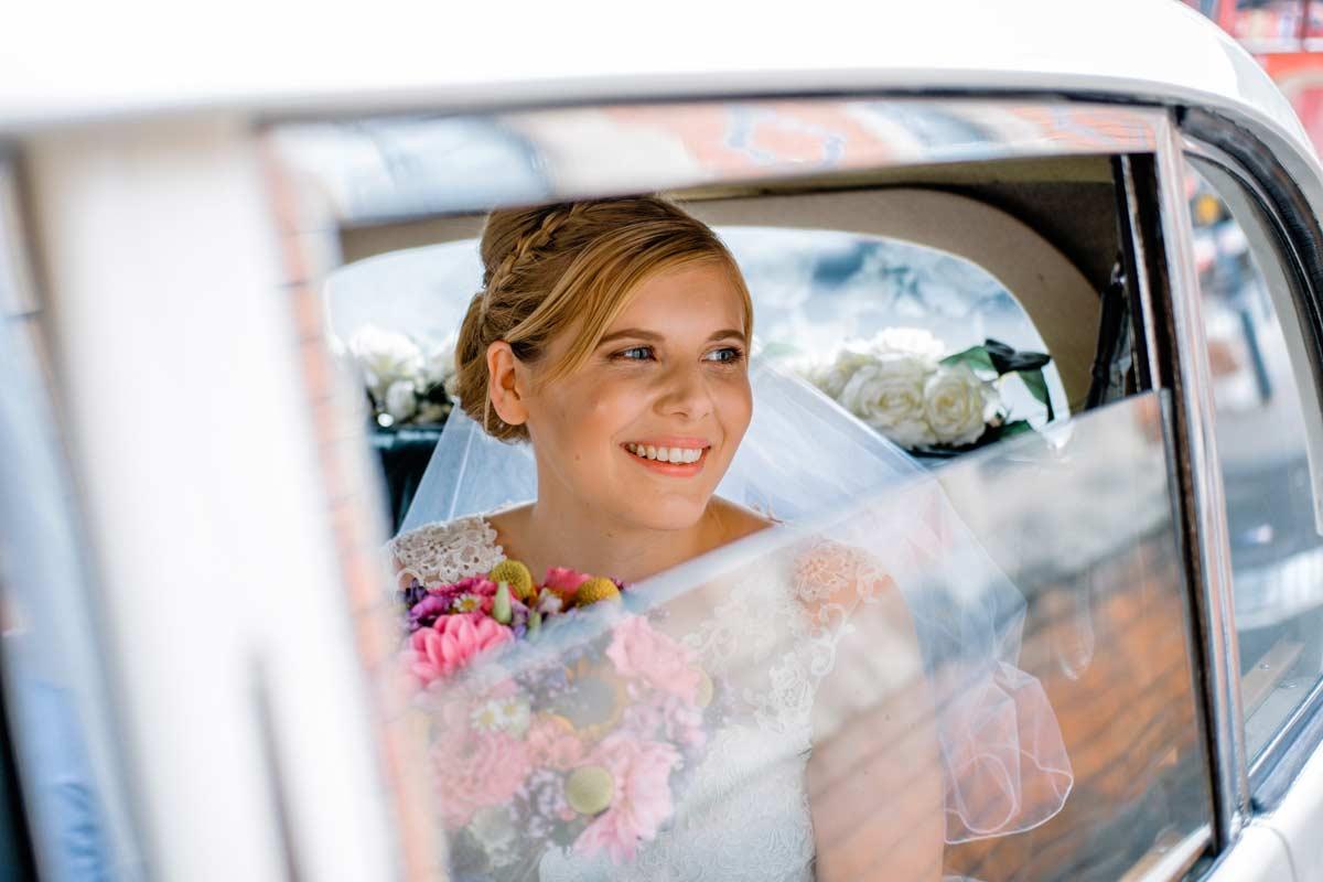 Bride through wedding car window