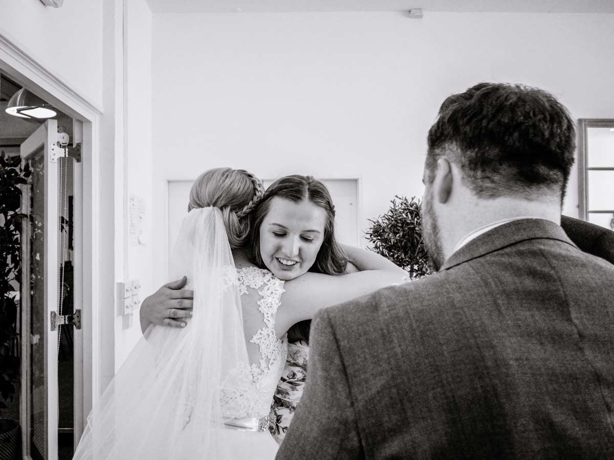 Woman hugging bride after her Old Library wedding ceremony