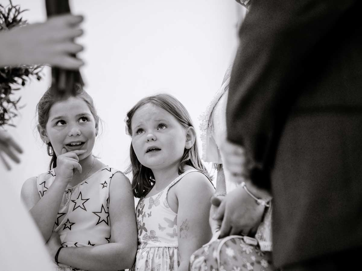 Children at a wedding watching bride and groom