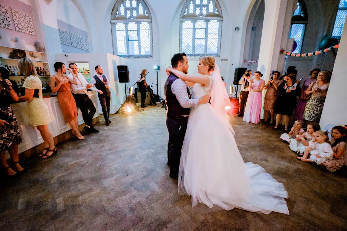 Bride and groom first dance at their old library wedding reception