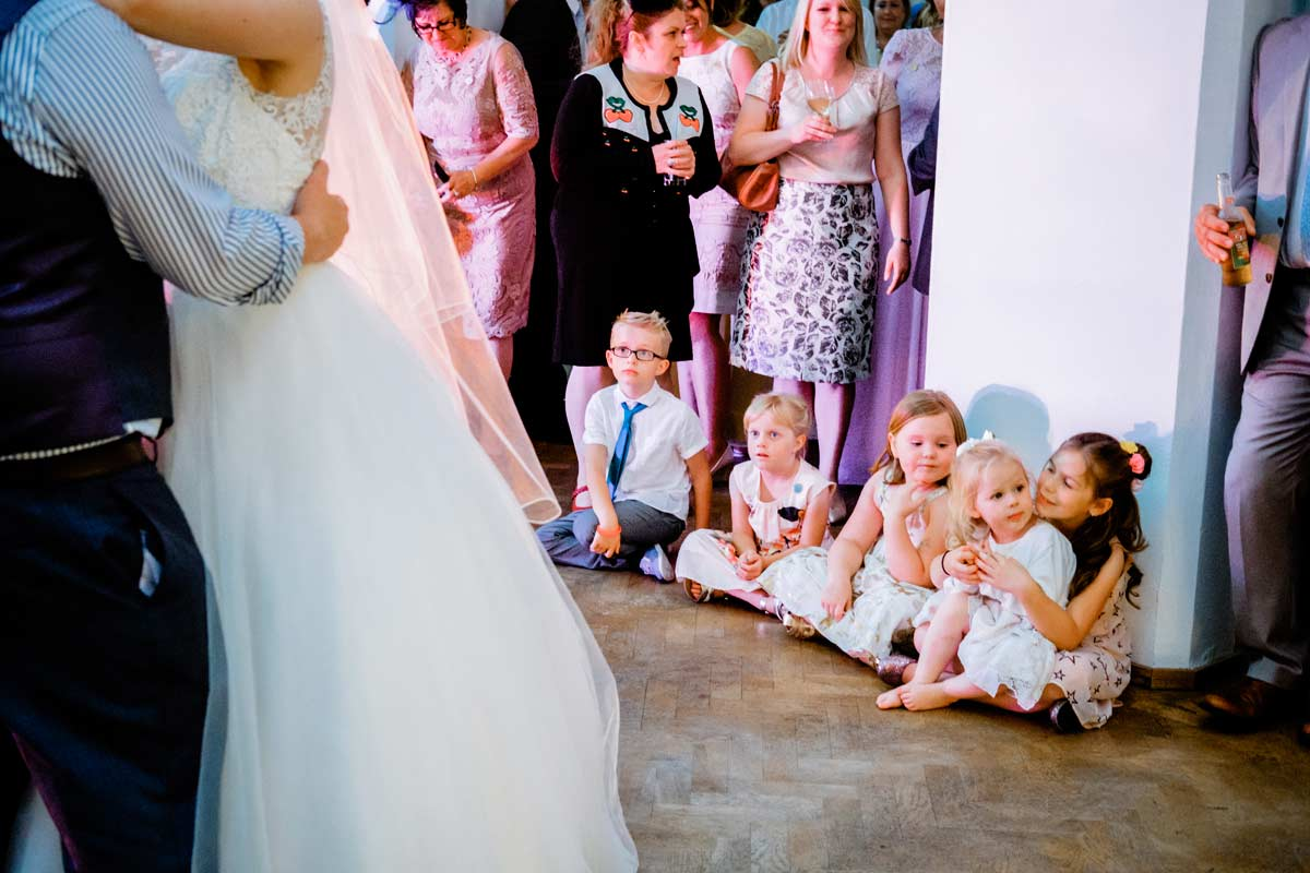 Children watching bride and groom dancing