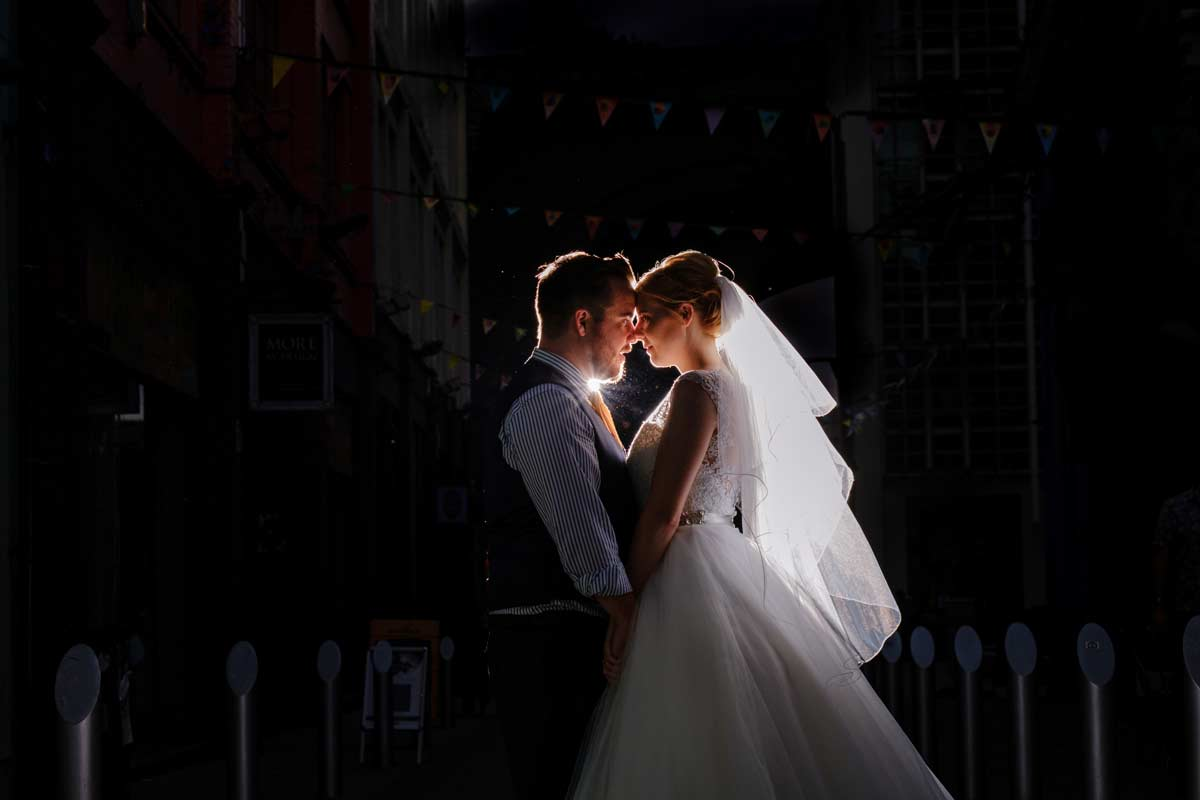 bride and groom back-light in The Custard Factory