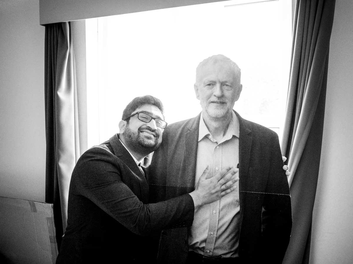 Wedding guest with cardboard cutout of Jeremy Corbyn