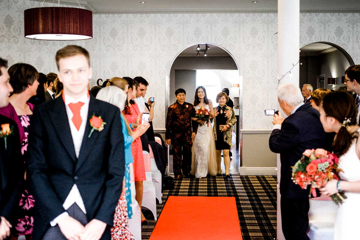Groom waiting for his bride to walk up the aisle