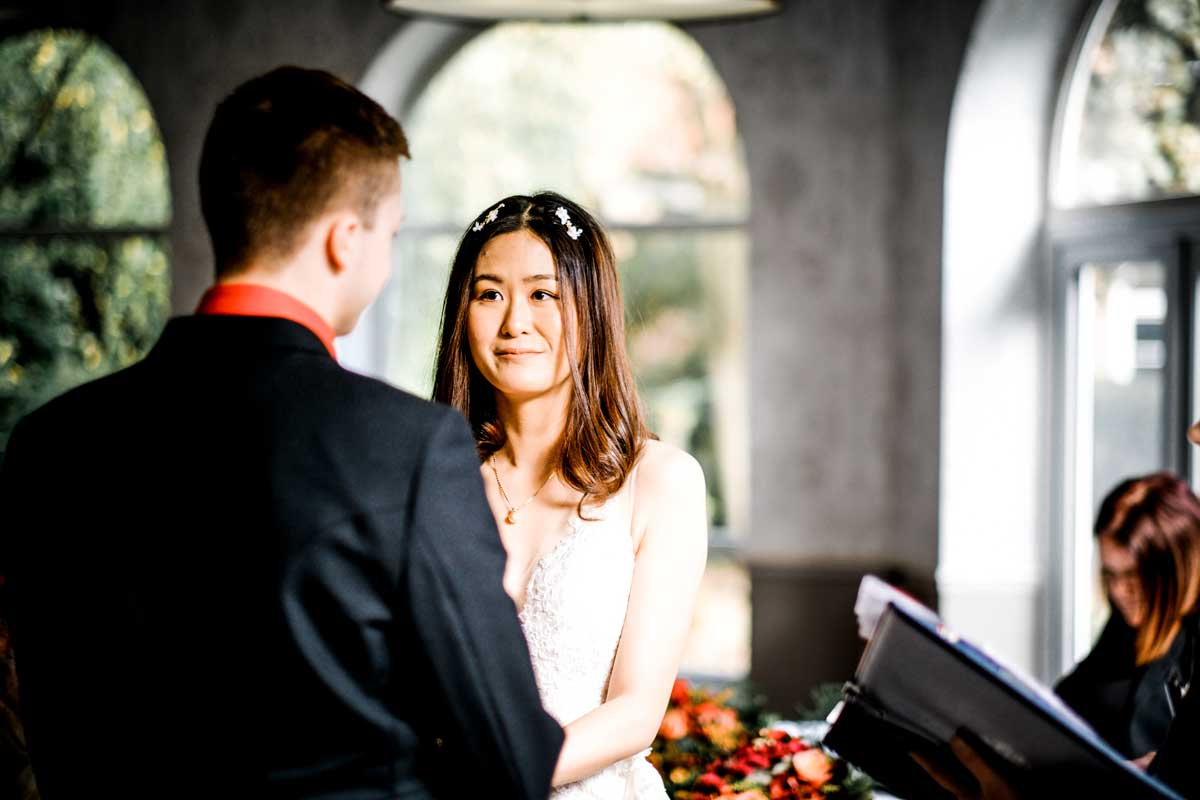 Happy bride during her wedding vows, as she know how to plan your wedding from abroad