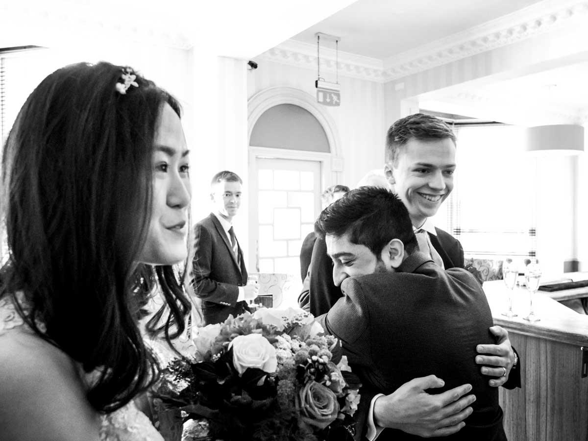 Man hugging groom