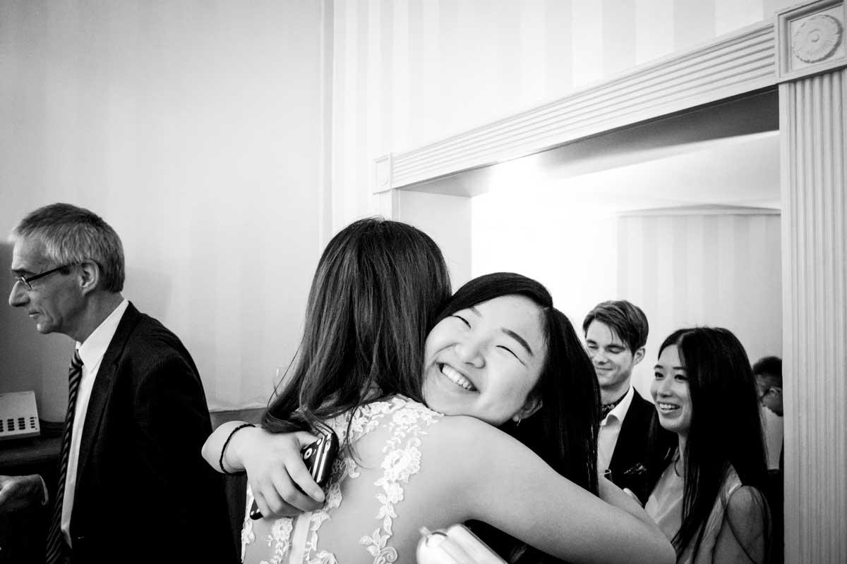 Woman guest hugging bride
