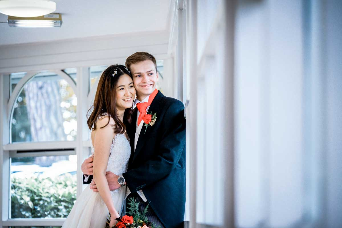 Happy bride and groom knowing they' know the answer to how to plan your wedding from abroad