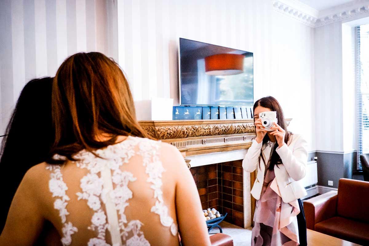 Woman taking polaroid picture