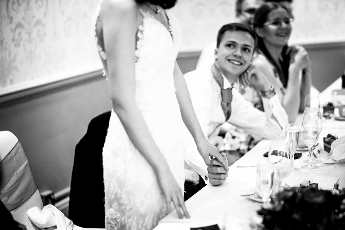 Bride looking at her father during wedding speeches
