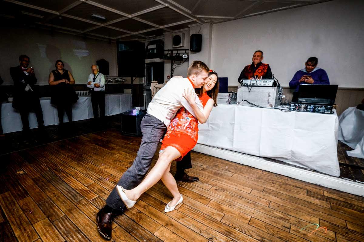 Groom dancing with his bride