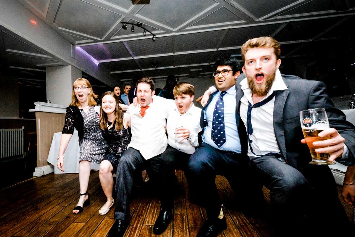 Man screaming into camera while dancing at wedding reception