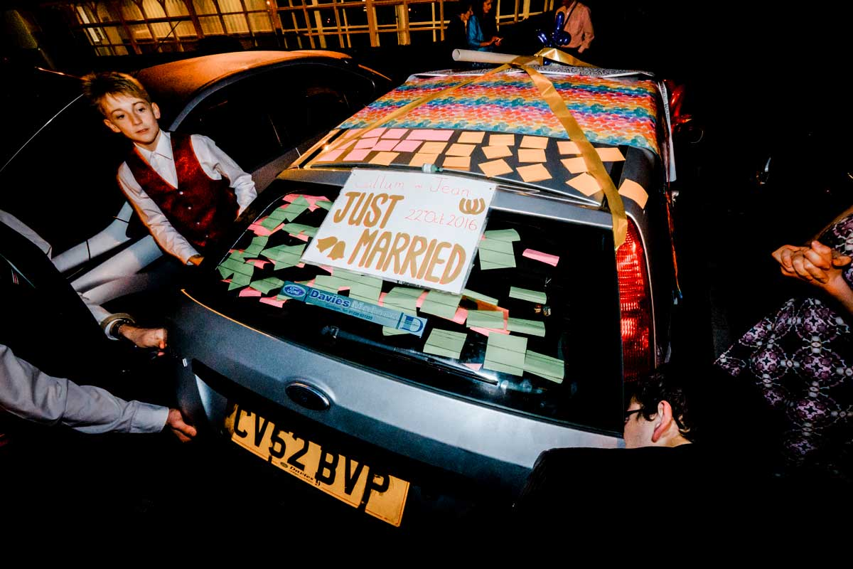 Putting balloons inside the bride and groom's wedding car as a surprise